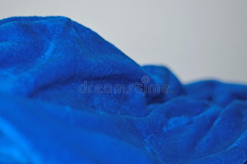 Abstract lens blur blue soft fabric. Abstract background with lens blur soft blue soft fabric royalty free stock photos