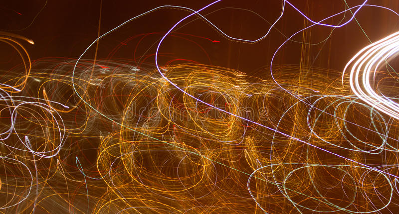 Abstract background of light bulbs at night in motion royalty free stock photography