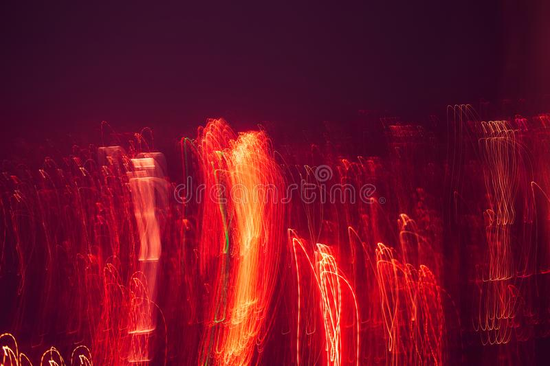 Abstract background with lights and movement, lines and lights in blur. Red flashes on black background stock image