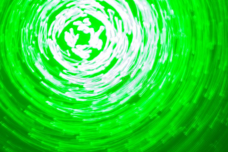 Abstract background of luminous circles in green and white colors stock image