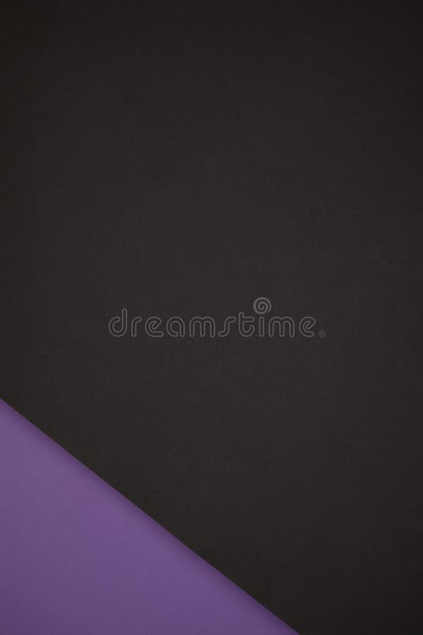 Abstract background made from black and purple colored paper stock photography
