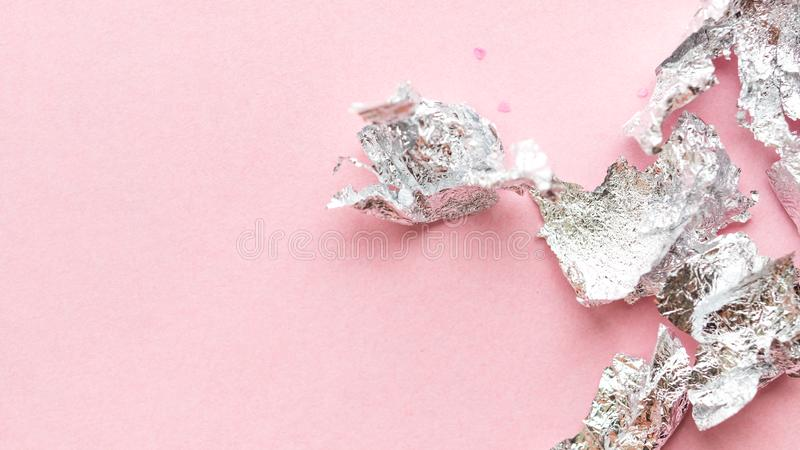 Abstract background made of crumpled foil. Abstract background made of crumpled foil  on pink paper background. Place for text stock images