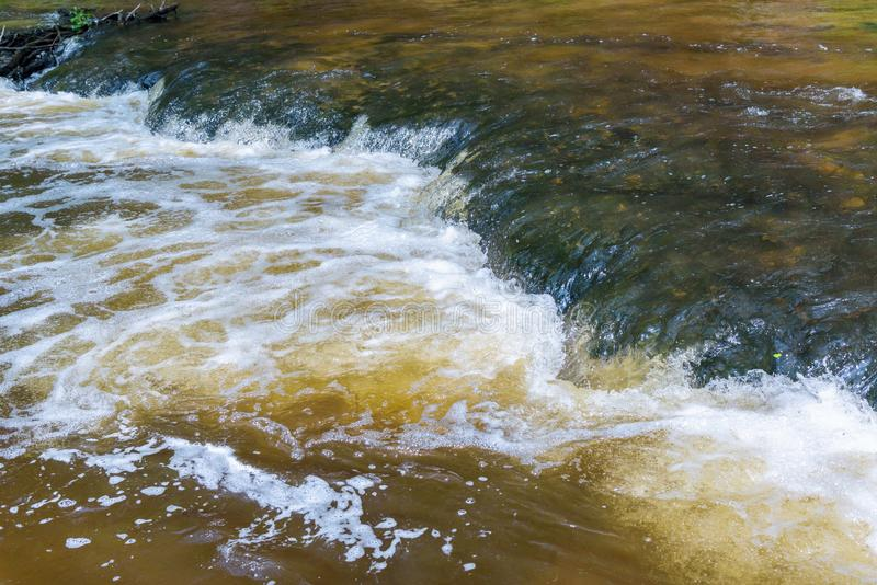 Abstract background made of flowing water. Abstract natural background made of flowing water in the river royalty free stock image