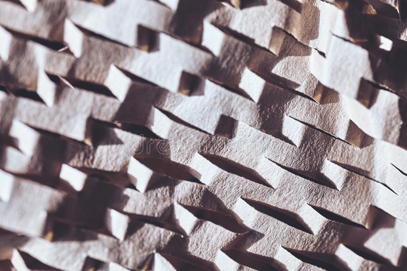 Abstract background made of perforated brown paper royalty free stock image