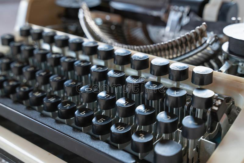 Abstract background with metal part and elements of typewriter. Abstract background with metal part and elements of retro-writing machine. keyboard with black royalty free stock image