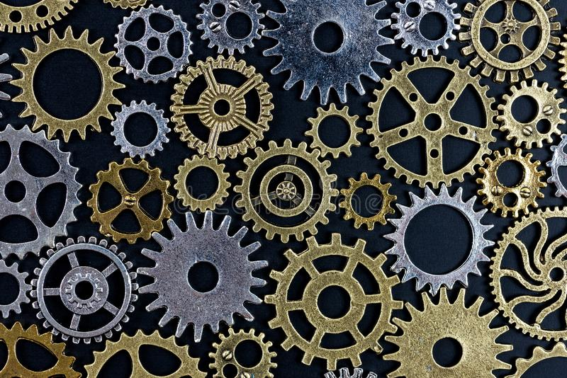 Abstract background of metelic gear on black background.  royalty free stock photos