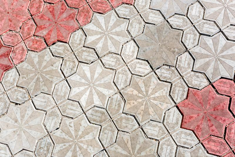 Abstract background of old stone pavement with pattern, close up image stock photography