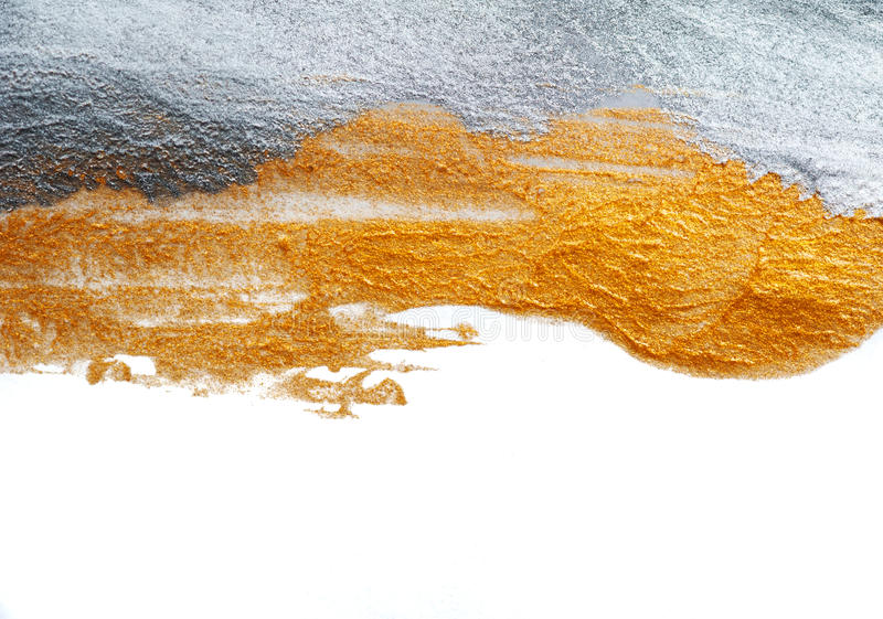 Abstract background painted with a brush of gold and silver paint.  royalty free stock images