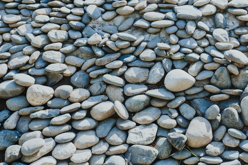Abstract background with pebbles. Round sea stones royalty free stock images