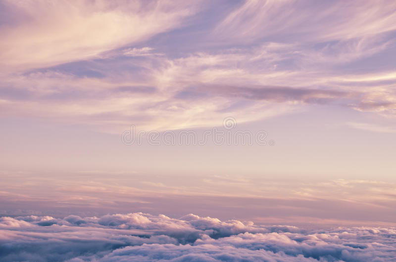 Abstract background with pink, purple and blue colors clouds. Sunset sky above the clouds. royalty free stock image