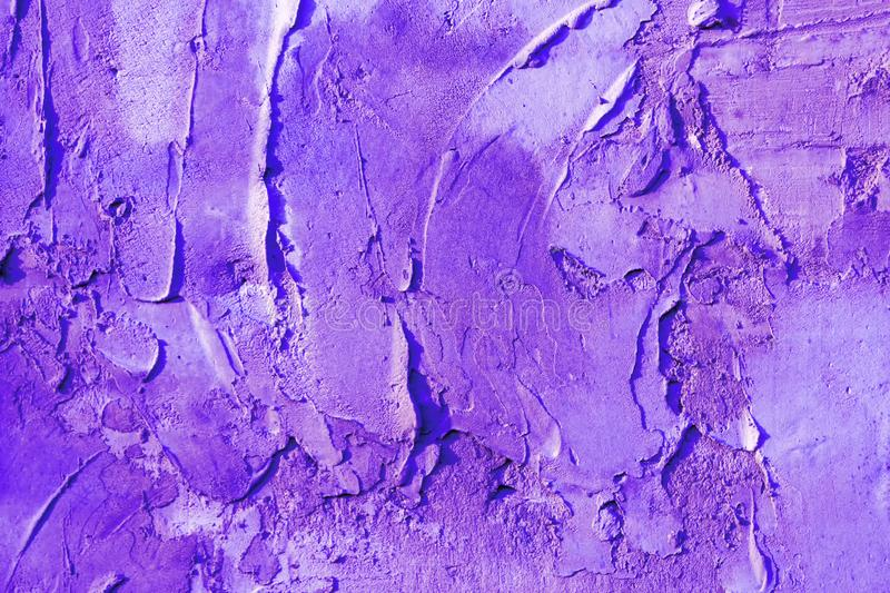 Abstract background plaster on the wall, painted in ultraviolet color. royalty free stock image