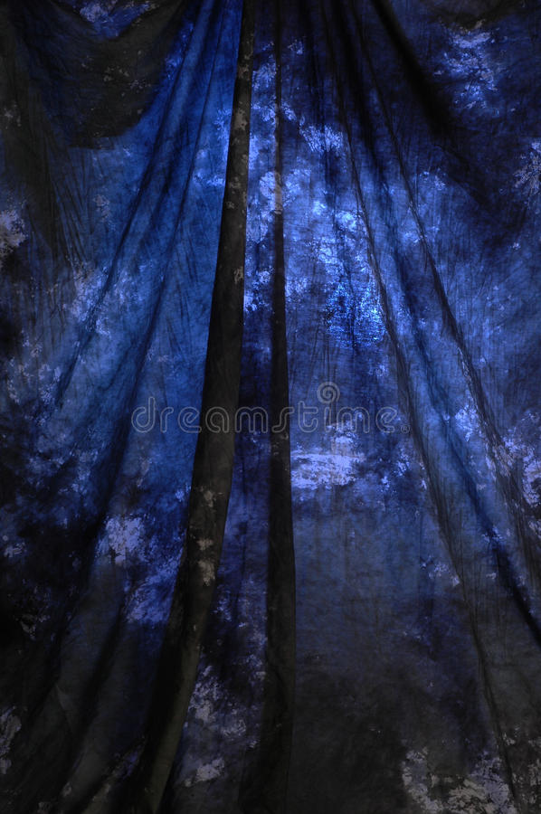 Abstract background of portrait muslin backdrop. Background abstract of portrait muslin background with wrinkles. ranging from deep blup at the top to light blue stock photos