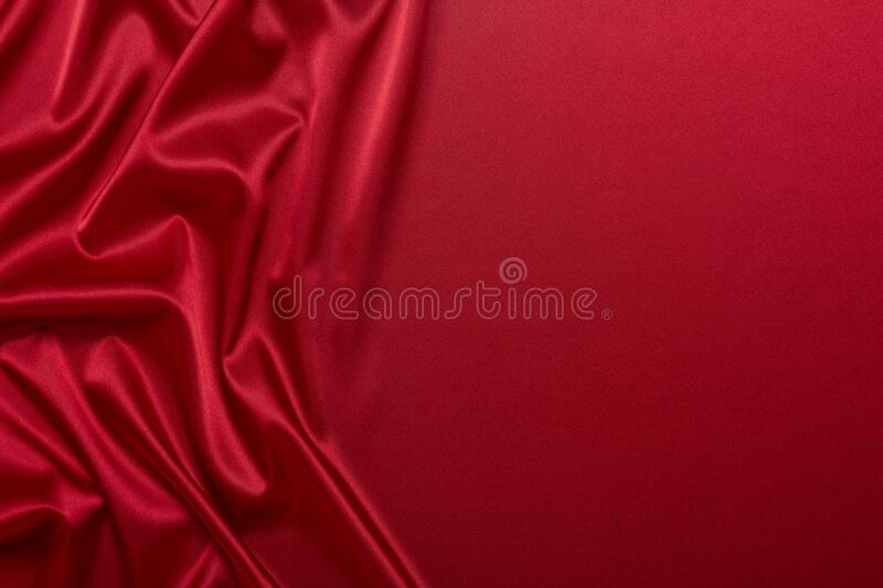 Abstract background from red silk or satin. Luxury fabric texture with draped. Copy space. Element design. Valentine`s day. Abstract background from red silk or royalty free stock images