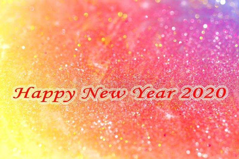 Happy New Year 2020 abstract background concept. Abstract background with red words Happy New Year 2020 and colorful bokeh glisters for happy new year royalty free stock photography