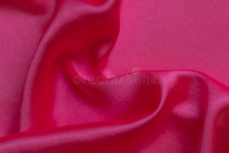 Abstract background, rippled pink silk royalty free stock photo