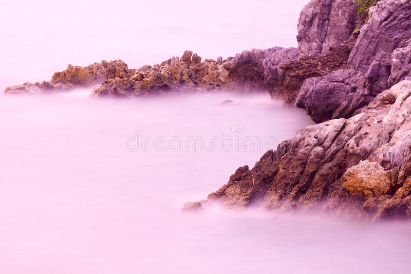 Abstract background of rock reef and sea water in the morning stock photography