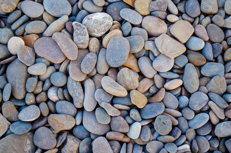 Abstract background round pebble stones in vintage style royalty free stock photo