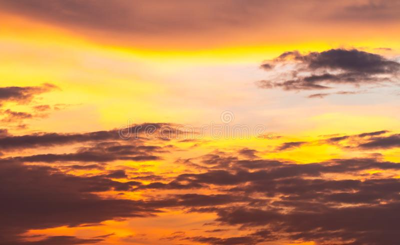 Abstract background, scenery of dramatic sky in evening. With storm clouds, blue, grey, orange, golden light in twilight, looks like watercolor painting royalty free stock photo