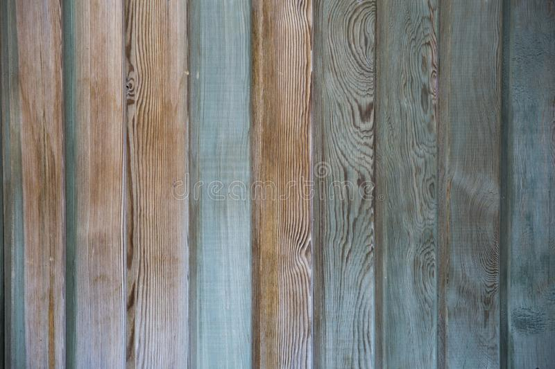 Abstract background of a shabby wooden surface painted in blue,. Simple abstract background of a shabby wooden surface painted in blue, turquoise, light brown royalty free stock photography