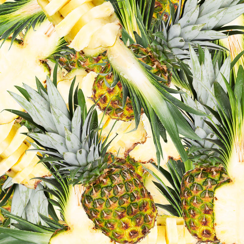 Abstract background with slices of fresh pineapple. Seamless pattern for a design. Close-up. Studio photography stock photo