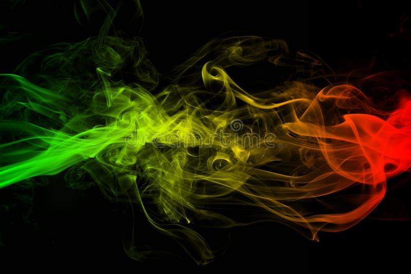Abstract background smoke curves and wave reggae colors green, yellow, red colored in flag of reggae music stock images