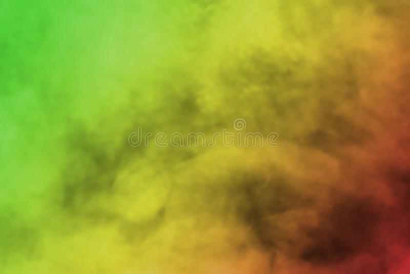 Abstract background smoke curves and wave reggae colors green, yellow, red colored in flag of reggae music stock photography