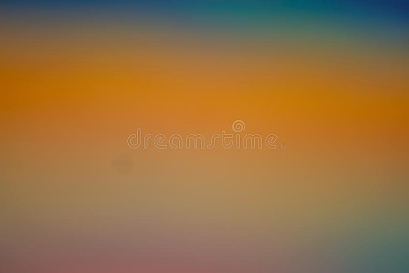 Warm autumn background in orange gold yellow and blue. Abstract background : summer colorful tones dreamy beautiful stock images