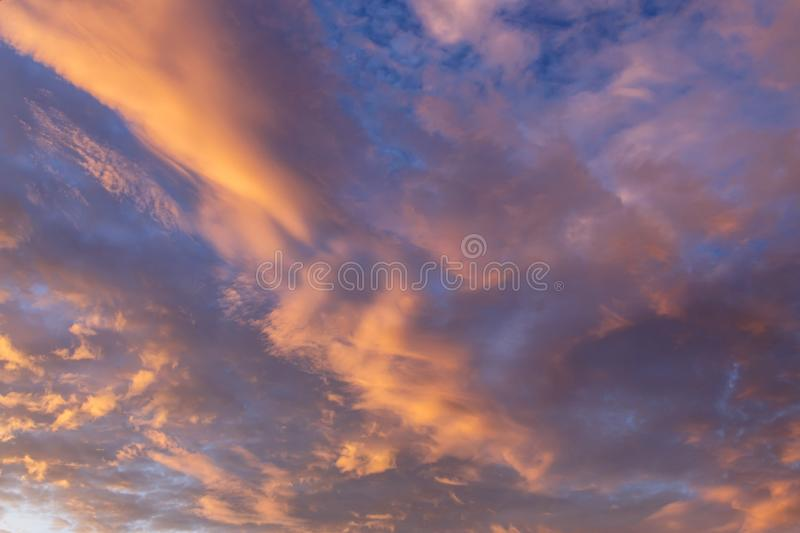 Abstract background with a texture of clouds at sunset. Heavenly royalty free stock photography