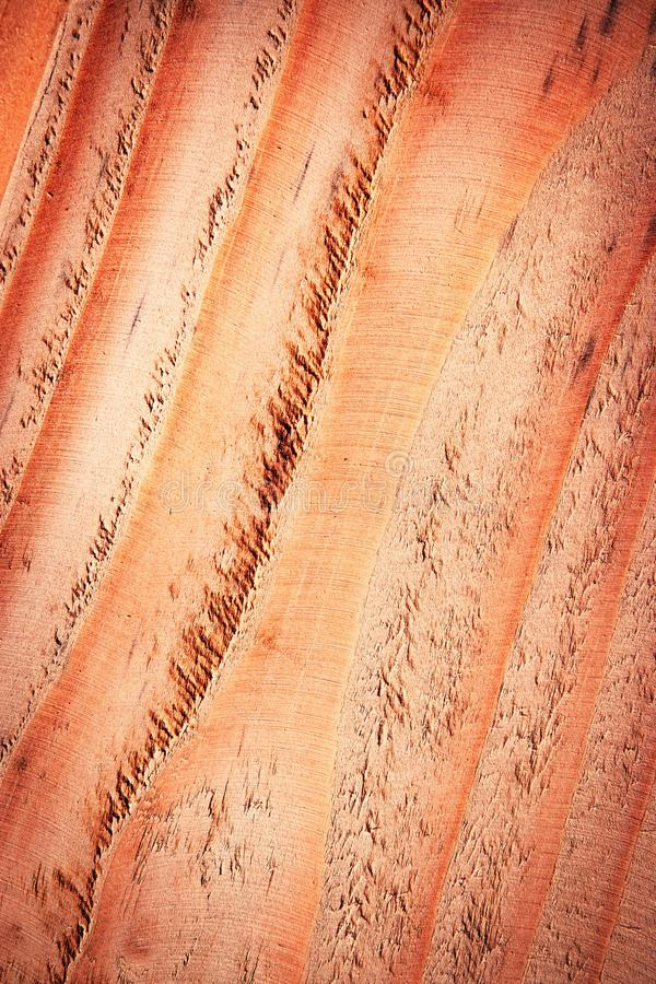 Oblique lines on red tinted wood royalty free stock image