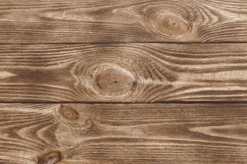 Texture of brown wood. Three boards. Abstract background. Empty template. royalty free stock image