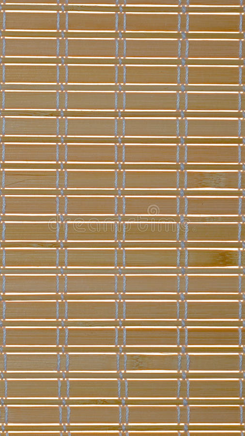 Abstract background of thin narrow strips woven with thick white silk threads stock image