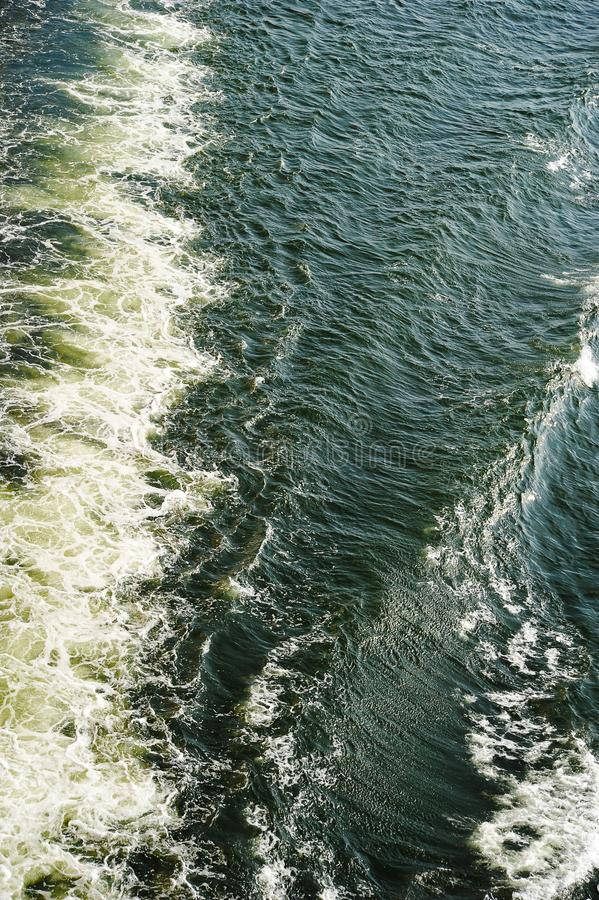 Abstract background-trace of the ship on the water surface stock images