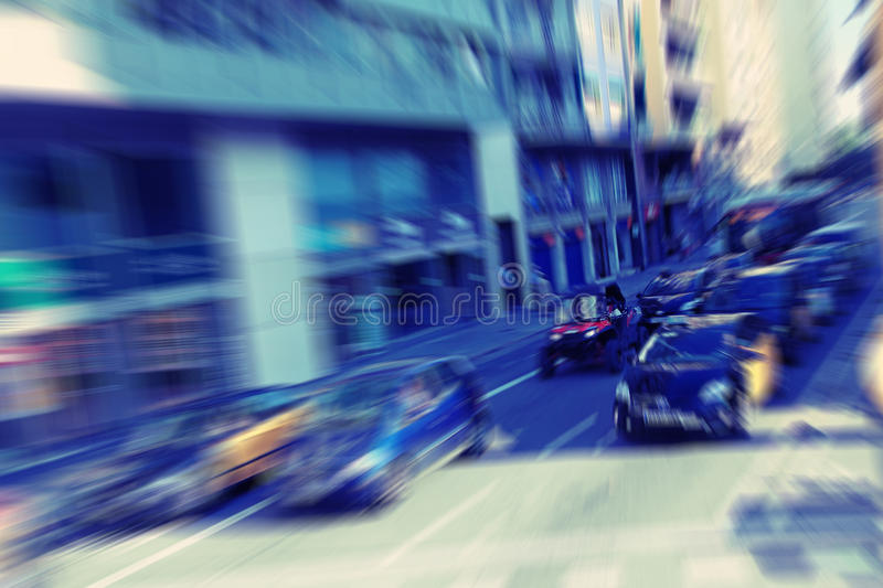 Abstract background. Traffic blur motion in modern city - rush hour in Barcelona, Spain. Radial zoom blur effect defocusing filter applied, with vintage royalty free stock photo