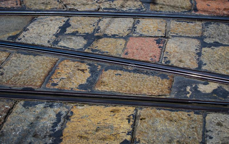 Abstract background tram rails close-u. P on the streets of Milan royalty free stock images