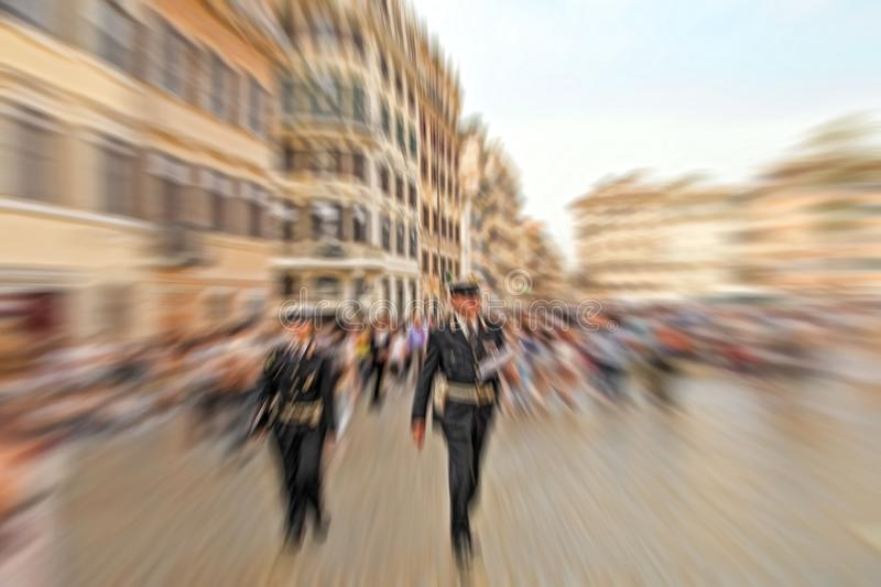 Abstract background. Two police officers walking along the streets of Rome, Italy. Radial zoom blur effect defocusing filter royalty free stock photos