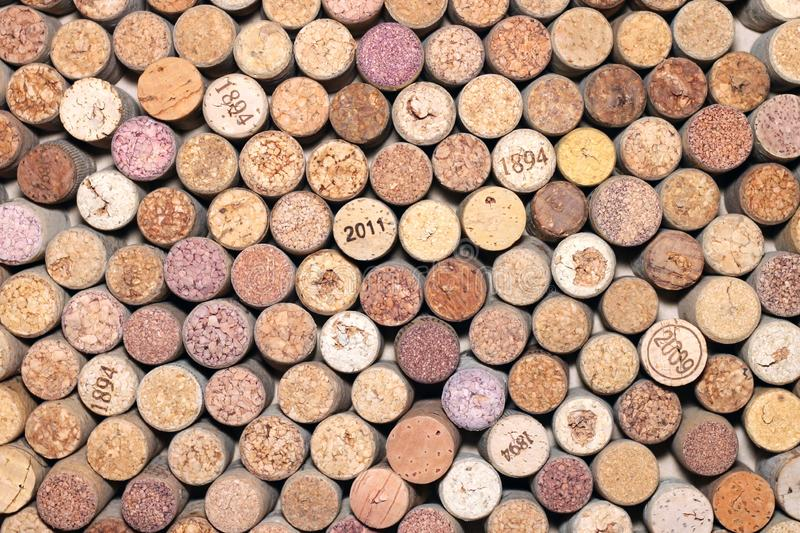 Abstract background of used wine corks with corkscrew marks on corks and calendar dates on some corks. Abstract background of used red and white wine corks with royalty free stock photo