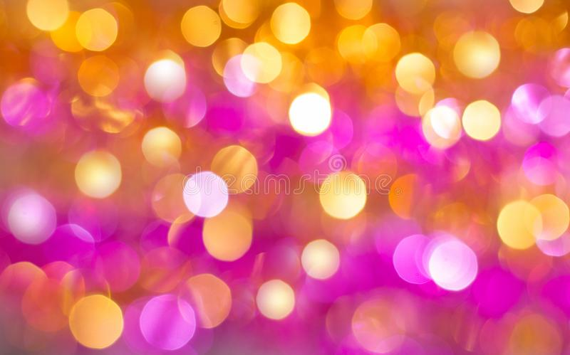 Abstract background in warm colors with bright colorful luminous bokeh royalty free stock images