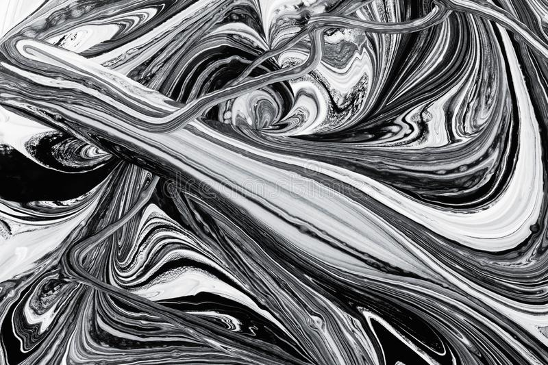 Abstract background, white and black mineral oil paint on water. Abstract background pattern texture, white and black mineral oil marble painting on water, stone royalty free stock images