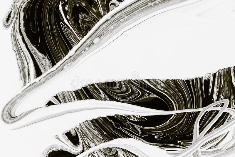 Abstract background, white and black mineral oil paint on water. Abstract background pattern texture, white and black mineral oil marble painting on water, stone royalty free stock photography