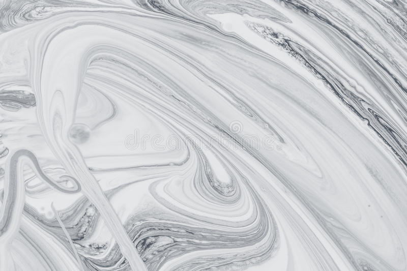 Abstract background, white and black mineral oil paint on water. Abstract background pattern texture, white and black mineral oil marble painting on water, stone stock photography