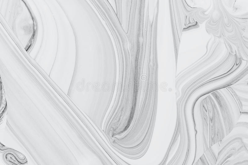 Abstract background, white and black mineral oil paint on water stock image