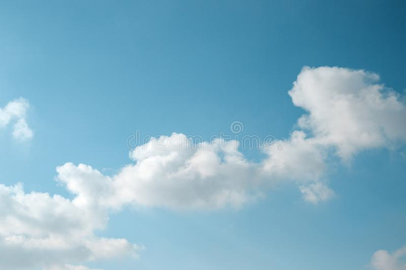 Abstract background of light blue sky and diagonal fluffy cloud. royalty free stock images