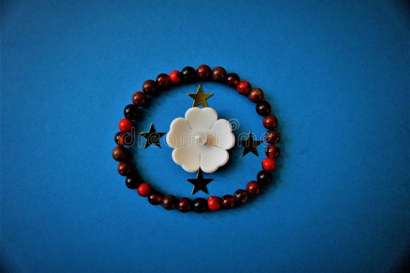 White flower and beads stock photo