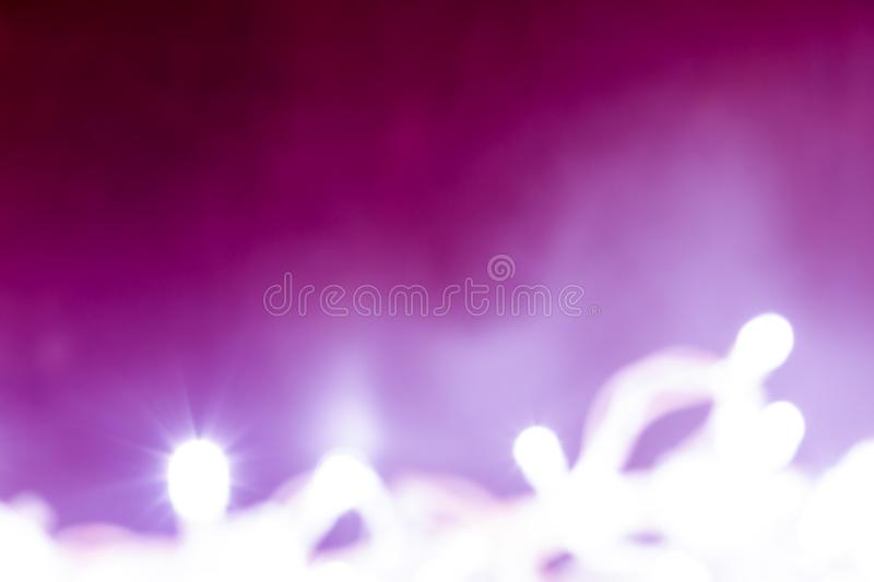 Abstract background of white lights with ultraviolet degrade stock photos