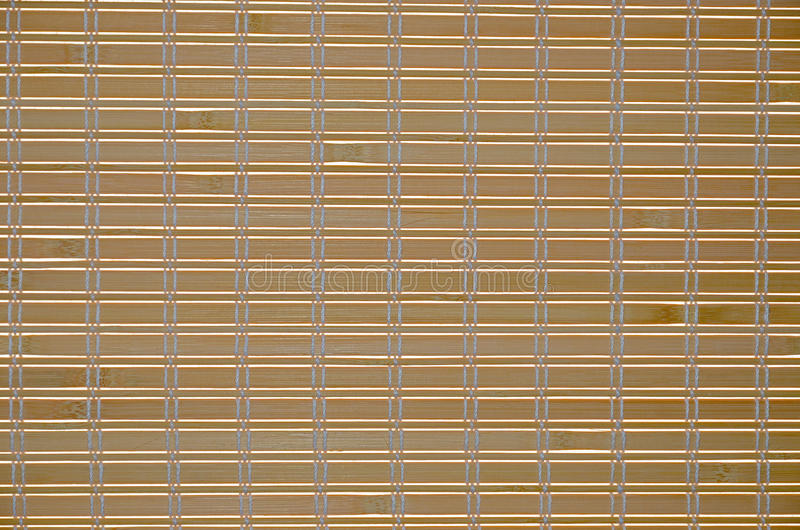 Abstract background wooden blinds against of bright sunlight closeup stock photo