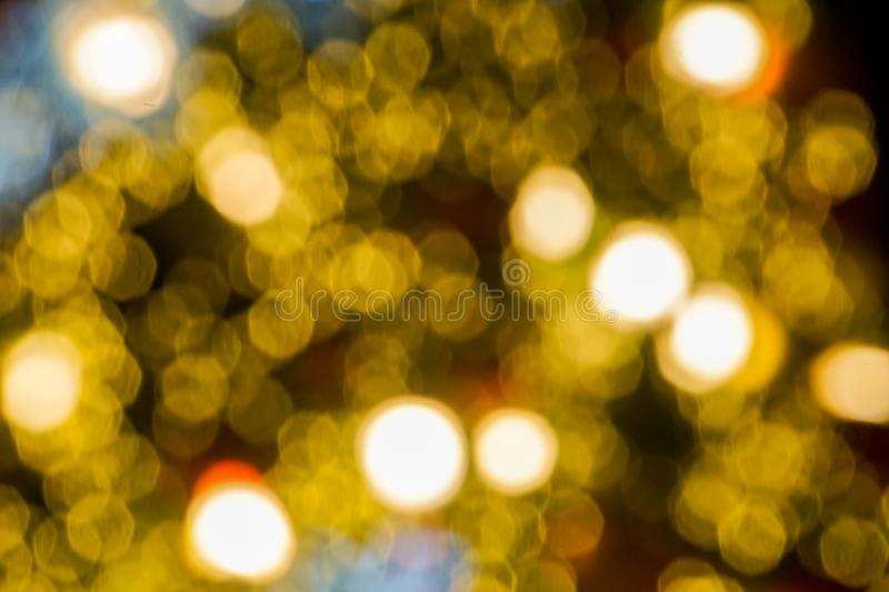 Abstract background - yellow gold light sparkling bokeh stock photo