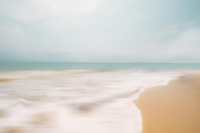 Abstract beach background, panning motion blur. A seascape abstract beach background. panning motion blur with a long exposure, pastel colors in a vintage and stock images