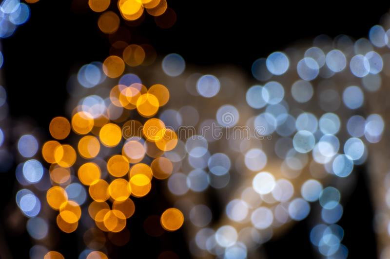 Abstract beautiful blurred background with a group of yellow and blue circles from lighted lamps can be used for a royalty free stock photo