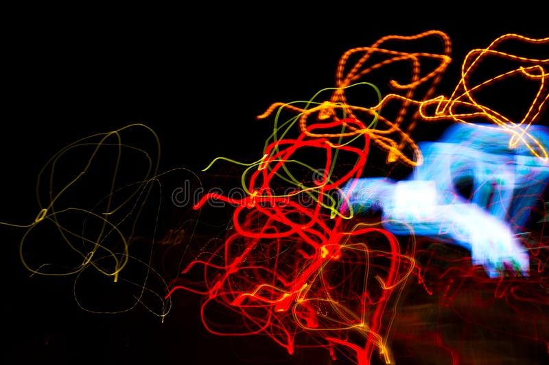 Abstract beautiful light painting photography, waves abstract light on black background stock images