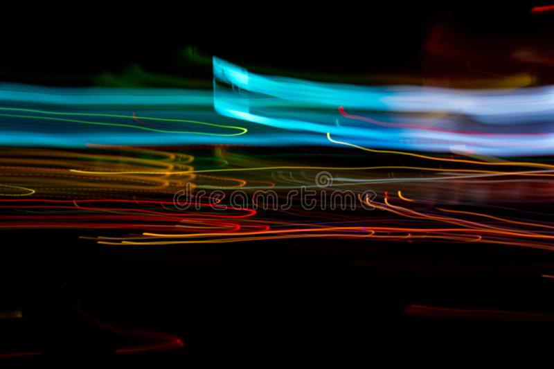 Abstract beautiful light painting photography, waves abstract light on black background royalty free stock images